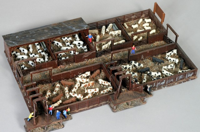 Upgraded Walthers Cornerstone cattle stockyard kit in HO scale.