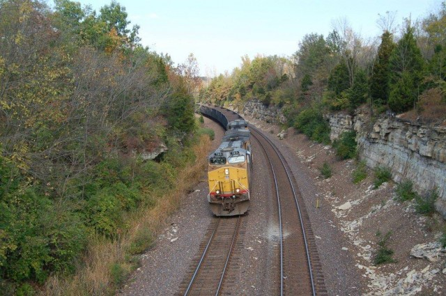 UP AC 44CW #7213 coming down grade just east of Eureka; in a matter of a couple hundred feet they will pass beneath historic Route 66 and almost immediately under I-44 on their westward journey back to the coal fields.