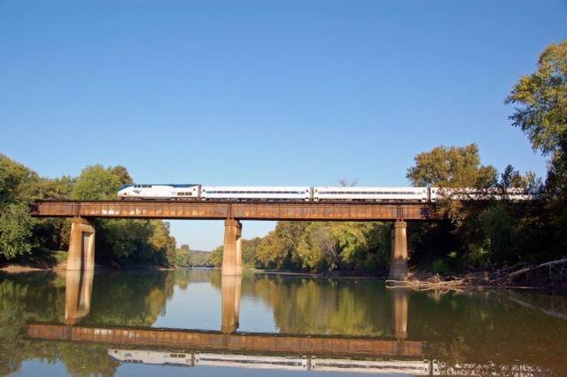 Amtrak's morning train to Kansas City crosses the Meramec River at Sherman Beach.
