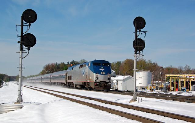 Amtrak's Pennsylvanian kicks up the snow headed east in Cresson, April 24.