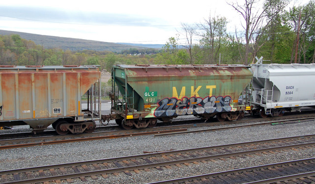 Especially for my Missouri friends ... an MKT covered hopper the graffiti artists have gotten to.