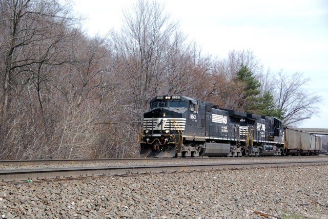NS power leads a string of coal empties around the curve at Lilly.
