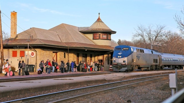 Amtrak's westbound Missouri River Runner calls at historic and busy Kirkwood Station.