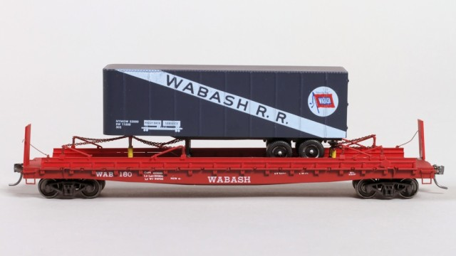 Side view of Wabash flat car and trailer.