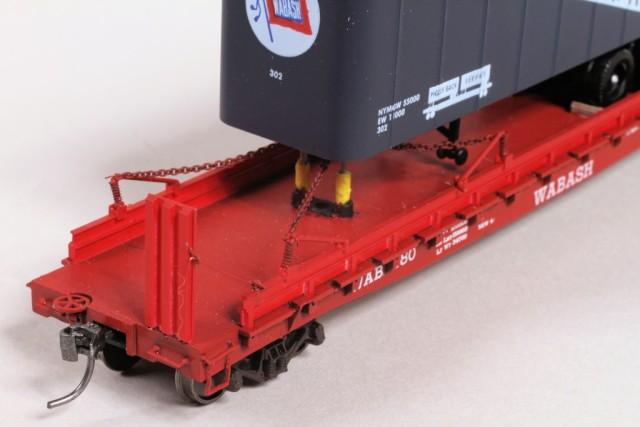 Closeup of flat, trailer and jacks.