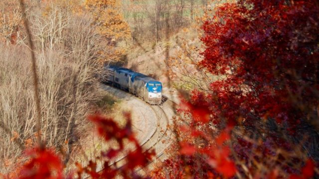 Amtrak's Capitol Limited speeds toward Washington, D.C. along Mance Curve on the old B&O line west of Cumberland, Maryland. This is just east of railfan favorite Sand Patch.