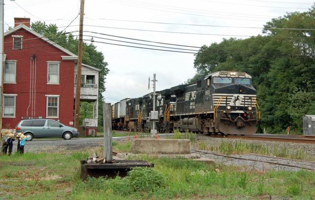 Westbound freight at Mattawana, Pennsylvania. Note the young children in the middle of the photo at the far left. I missed the better shot on the previous passing train when they were closer to the track, but when mom saw me raise the camera, made them move back.