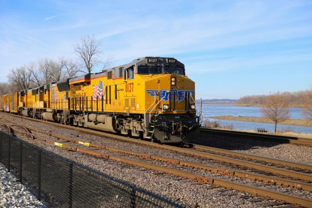 Rolling along. This east bound UP freight at track speed along the former MoPac right-of-way in Washington, Missouri. That's the Missouri River in the background.