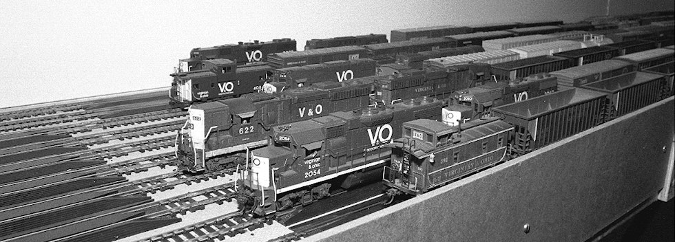 Virginian & Ohio trains are ready to roll from this hidden staging area. Note the use of rerailers on each staging track to assist changes of equipment.