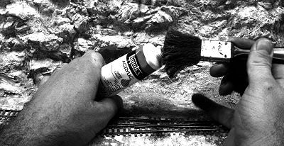 Squeeze the paint tube until paint just comes out. Gently rub the brush over the paint.