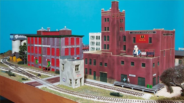 The tall buildings separate this switching area from the rest of the layout.