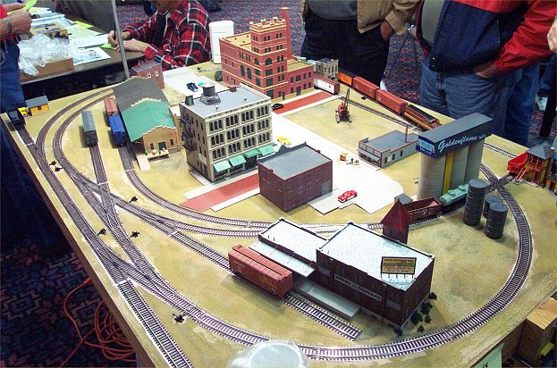 An early photo of the layout still under construction being displayed at a train show.