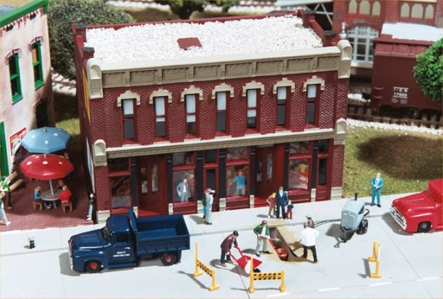 "The building and ""construction scene"" on the MHS model railroad."