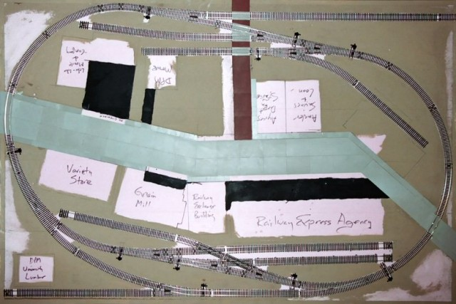 Track and building placement was drawn on the layout base as a guide.