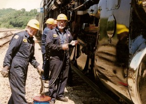 Two guys and a grease gun - the main rods and side rods were greased at each service stop.