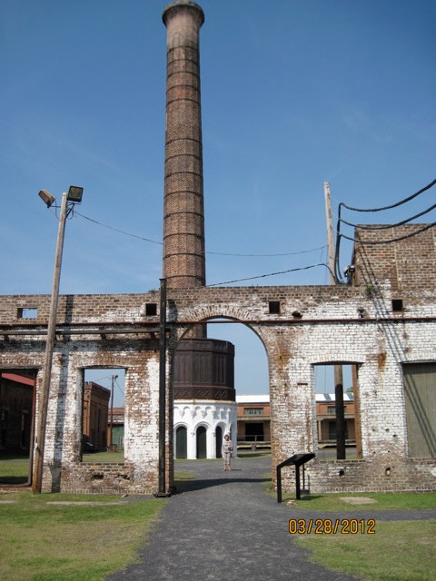 Ornate 126' smokestack with surviving building walls of the Central of Georgia RR complex in Savannah, Georgia.