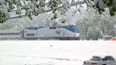 Monday morning, we awoke to a snowstorm ... on April 23rd! Amtrak's Pennsylvanian headed east.