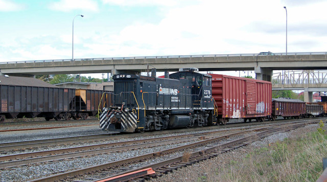 Switching beside the coal empties leaving town.