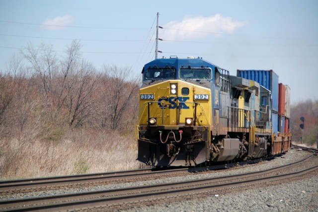 We saw lots of foreign power. Here, CSX is on the point of this stack train; we're behind the Portage Rail Museum.