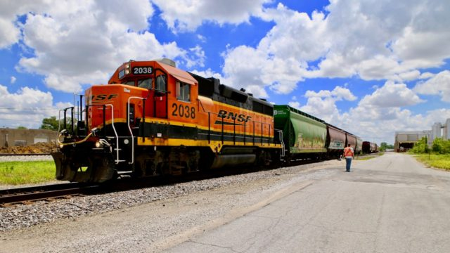 This BNSF GP38-2 is switching the Pinnacle Foods, Inc. plant in the background. A larger railroad yard, located in an industrial park, is beyond the plant, which manufactures cake mix for Duncan Hines.