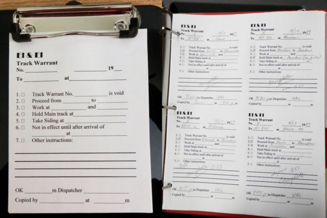 Track warrant on clipboard (left) and track warrant notebook for dispatcher (right).